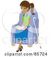 Blind Hispanic Woman Sitting In A Chair And Reading Braille Her Cane At Her Side