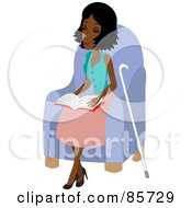 Blind Black Woman Sitting In A Chair And Reading Braille Her Cane At Her Side