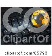 3d Orange Globe On Top Of A Black Computer Keyboard