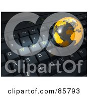 Royalty Free RF Clipart Illustration Of A 3d Orange Globe On Top Of A Black Computer Keyboard