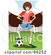 Tough Soccer Player Resting His Foot On The Ball By A Goal