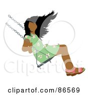 Hispanic Girl Swinging On A Playground