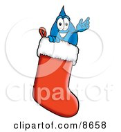 Water Drop Mascot Cartoon Character Inside A Red Christmas Stocking