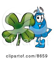 Water Drop Mascot Cartoon Character With A Green Four Leaf Clover On St Paddys Or St Patricks Day