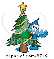 Water Drop Mascot Cartoon Character Waving And Standing By A Decorated Christmas Tree