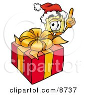 Clipart Picture Of A Broom Mascot Cartoon Character Standing By A Christmas Present by Toons4Biz