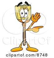 Broom Mascot Cartoon Character Waving And Pointing