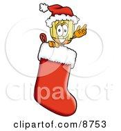 Broom Mascot Cartoon Character Wearing A Santa Hat Inside A Red Christmas Stocking