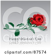 Red Rose And Bud With A Happy Valentines Day Greeting On Reflective Gray