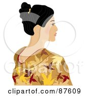 Beautiful Geisha Woman In A Gold Kimono