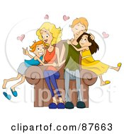 Loving Caucasian Family Of Four Snuggling On A Chair