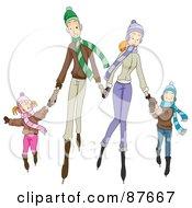 Happy Caucasian Family Of Four Ice Skating