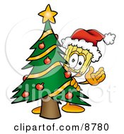 Broom Mascot Cartoon Character Waving And Standing By A Decorated Christmas Tree