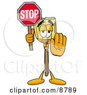 Broom Mascot Cartoon Character Holding A Stop Sign