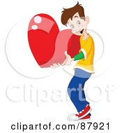 Sweet Brunette Teen Boy Holding A Giant Red Heart