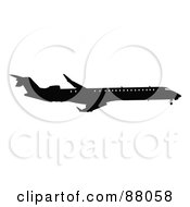 Royalty Free RF Clipart Illustration Of A Silhouetted Black Airplane With Windows Version 2 by JR
