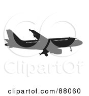 Royalty Free RF Clipart Illustration Of A Silhouetted Black Airplane With Windows Version 1 by JR