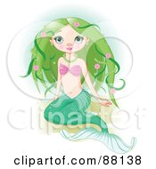Cute Mermaid With Green Floral Hair Sitting On Sand