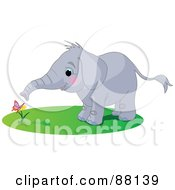 Royalty Free RF Clipart Illustration Of A Cute Elephant Watching A Butterfly On A Flower by Pushkin