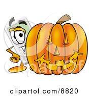 Calculator Mascot Cartoon Character With A Carved Halloween Pumpkin