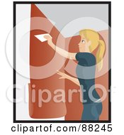 Caucasian Woman Using A Scraper To Apply Orange Wallpaper To Her Wall