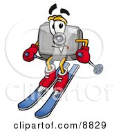 Clipart Picture Of A Camera Mascot Cartoon Character Skiing Downhill