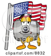 Clipart Picture Of A Camera Mascot Cartoon Character Pledging Allegiance To An American Flag by Toons4Biz