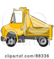 Side View Of A Yellow Dumptruck