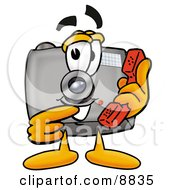 Clipart Picture Of A Camera Mascot Cartoon Character Holding A Telephone by Toons4Biz