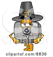 Clipart Picture Of A Camera Mascot Cartoon Character Wearing A Pilgrim Hat On Thanksgiving by Toons4Biz
