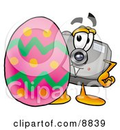 Clipart Picture Of A Camera Mascot Cartoon Character Standing Beside An Easter Egg
