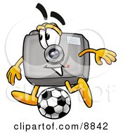 Clipart Picture Of A Camera Mascot Cartoon Character Kicking A Soccer Ball by Toons4Biz