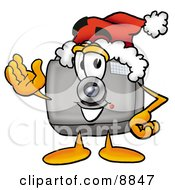 Clipart Picture Of A Camera Mascot Cartoon Character Wearing A Santa Hat And Waving by Toons4Biz