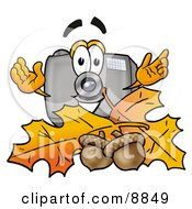 Clipart Picture Of A Camera Mascot Cartoon Character With Autumn Leaves And Acorns In The Fall