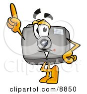 Clipart Picture Of A Camera Mascot Cartoon Character Pointing Upwards