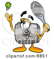 Clipart Picture Of A Camera Mascot Cartoon Character Preparing To Hit A Tennis Ball