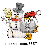 Clipart Picture Of A Camera Mascot Cartoon Character With A Snowman On Christmas