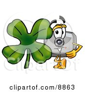 Camera Mascot Cartoon Character With A Green Four Leaf Clover On St Paddys Or St Patricks Day
