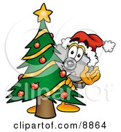 Clipart Picture Of A Camera Mascot Cartoon Character Waving And Standing By A Decorated Christmas Tree