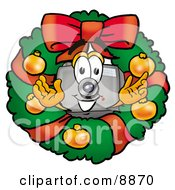 Clipart Picture Of A Camera Mascot Cartoon Character In The Center Of A Christmas Wreath