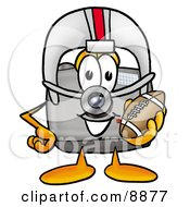 Clipart Picture Of A Camera Mascot Cartoon Character In A Helmet Holding A Football by Toons4Biz