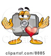 Camera Mascot Cartoon Character With His Heart Beating Out Of His Chest
