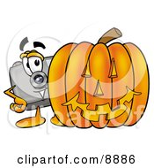 Clipart Picture Of A Camera Mascot Cartoon Character With A Carved Halloween Pumpkin