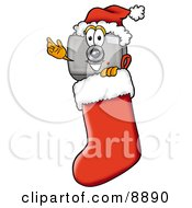Clipart Picture Of A Camera Mascot Cartoon Character Wearing A Santa Hat Inside A Red Christmas Stocking by Toons4Biz