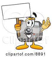 Clipart Picture Of A Camera Mascot Cartoon Character Holding A Blank Sign by Toons4Biz