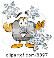 Clipart Picture Of A Camera Mascot Cartoon Character With Three Snowflakes In Winter