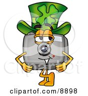 Clipart Picture Of A Camera Mascot Cartoon Character Wearing A Saint Patricks Day Hat With A Clover On It by Toons4Biz