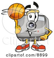 Clipart Picture Of A Camera Mascot Cartoon Character Spinning A Basketball On His Finger by Toons4Biz