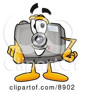 Clipart Picture Of A Camera Mascot Cartoon Character Pointing At The Viewer by Toons4Biz