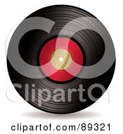 Black Vinyl Record With A Blank Red Label by michaeltravers